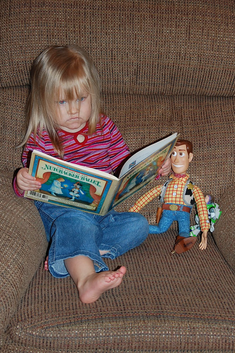 Claire reading to Buzz and Woody back in January